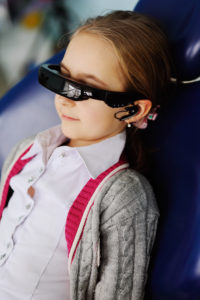 child to the dentist to watch a cartoon video glasses